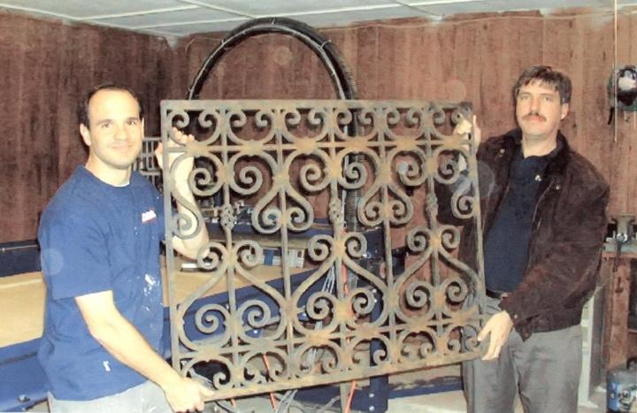Tableaux Co-Founders Christian Garces and Thomas Von Schimonsky holding original Faux Iron prototype